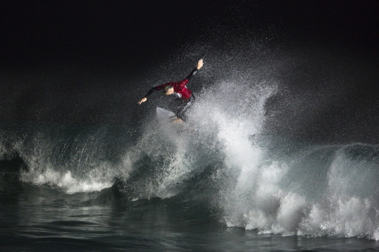 Image: A surfer rides a wave during a night-surfing competition in Ashdod