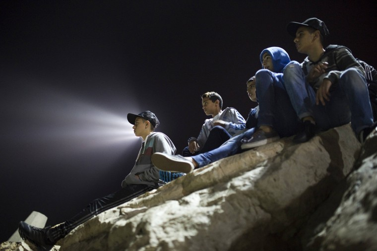 Image: Israeli spectators watch a night-surfing competition in Ashdod