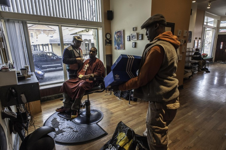 Image: Troy Staton has combined fine art with the art of barbering at his shop in Southwest Baltimore.