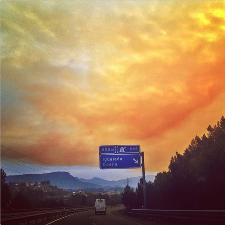 A toxic cloud fills the sky over a roadway outside Igualada, Spain.