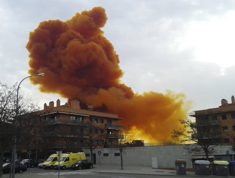 Image: A toxic cloud is seen over the skies of Igualada in north eastern Spain following an explosion in a chemical plant