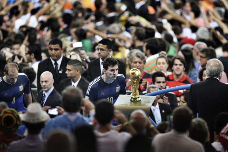 First Prize Sports Argentina player Lionel Messi comes to face the World Cup trophy during the final celebrations at Maracana Stadium in Rio de Janeiro, Brazil. His team lost to Germany 1-0, after a goal by Mario Götze in extra time.