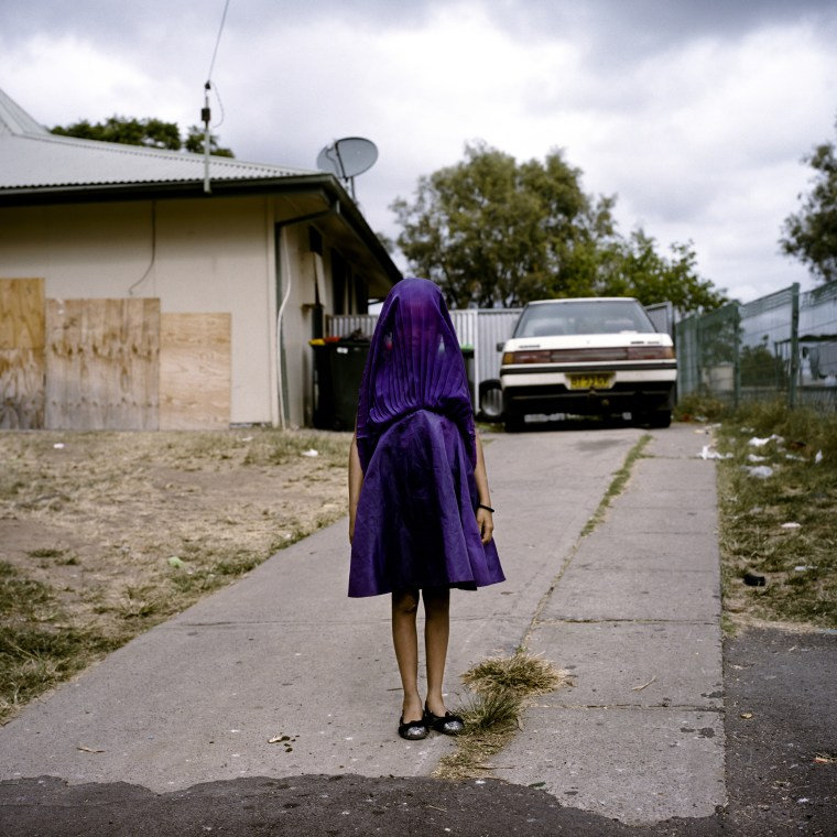 First Prize Portraits Category Laurinda waits in her purple dress for the bus that will take her to Sunday School in Moree, New South Wales, Australia. She is among the many socially isolated young women in disadvantaged communities in Australia facing entrenched poverty, racism, trans-generational trauma, violence, addiction, and a range of other barriers to health and well-being.