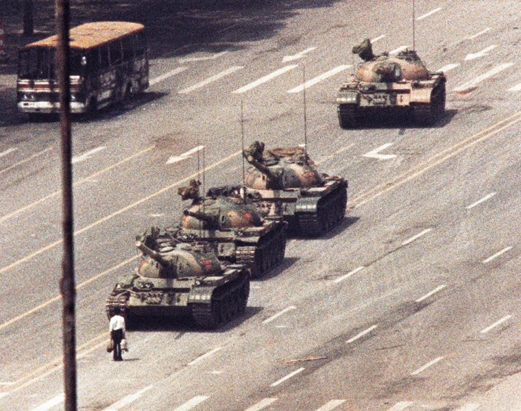 Image: File photo of a man standing in front of a convoy of tanks in the Avenue of Eternal Peace in Tiananmen Square in Beijing