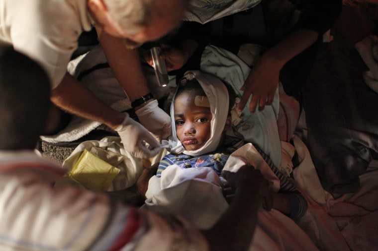 Image: File photo of an injured child receiving medical treatment after an earthquake in Port-au-Prince