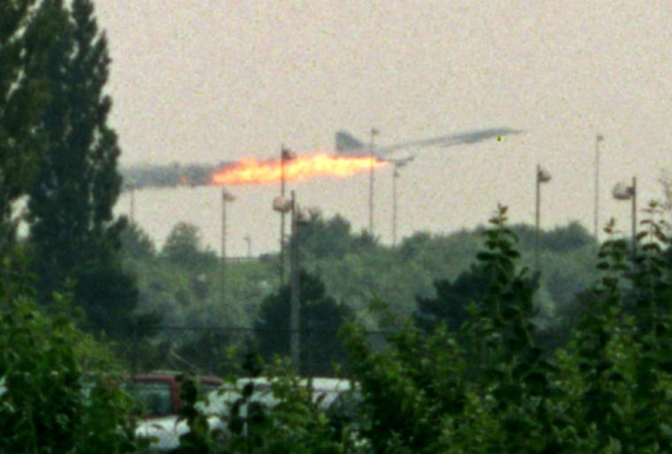 Image: File photo shows flames coming out of the Air France Concorde seconds before it crashed in Gonesse near Paris Roissy airport