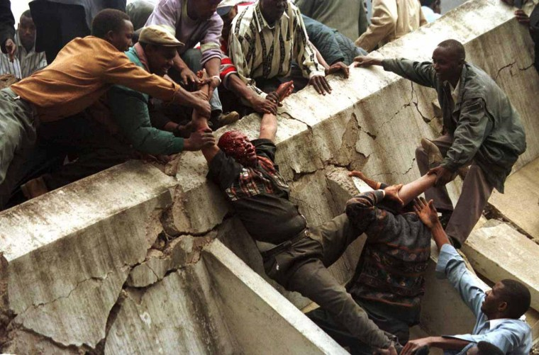 Image: File photo of a body being removed from the wreckage after a bomb went off in Nairobi