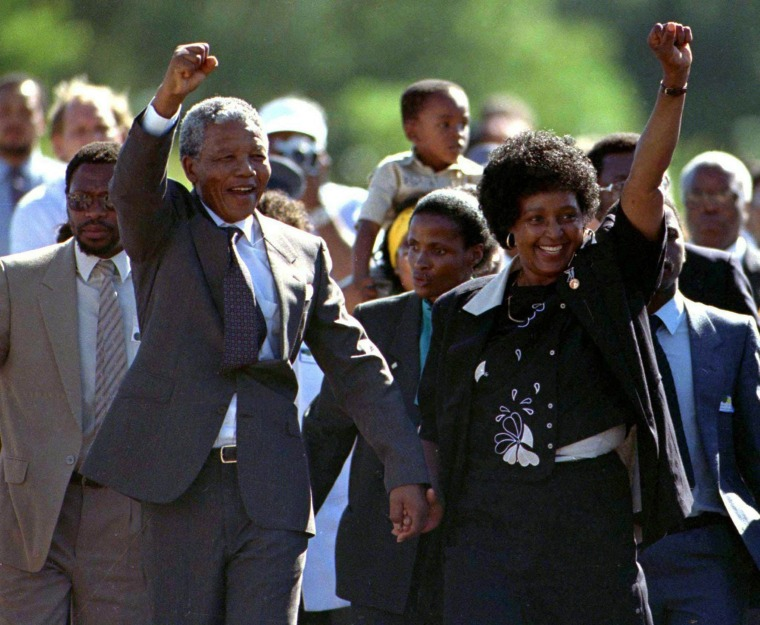 Image: File photo of Nelson Mandela accompanied by his wife Winnie, walking out of the Victor Verster prison, near Cape Town, after spending 27 years in apartheid jails