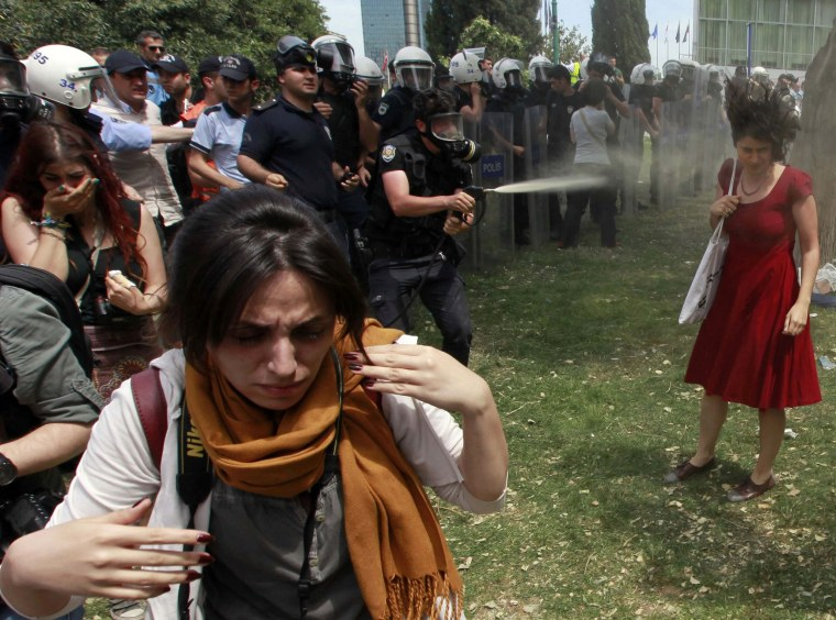 Image: File photo of a Turkish riot policeman using tear gas against protestors in Taksim Square