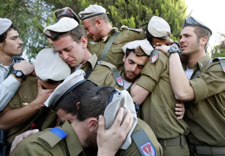 Image: File photo of Israeli soldiers mourning during the funeral of their comrade Alex Mashavisky at a cemetery in Beersheba