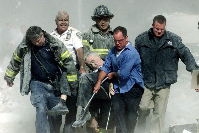 Image: File photo of rescue workers carrying fatally injured New York City Fire Department Chaplain, Father Mychal Judge from the World Trade Centre