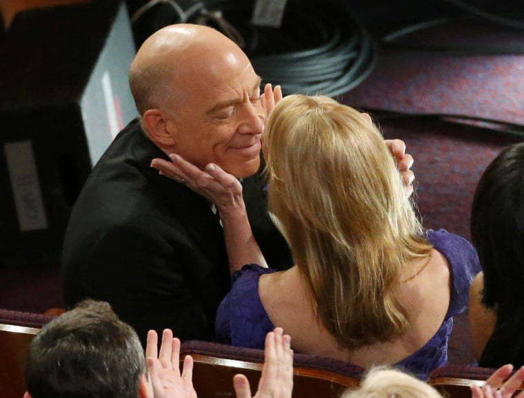 Image: Best supporting actor winner Simmons  is congratulated by his wife Michelle Schumache at the 87th Academy Awards in Hollywood