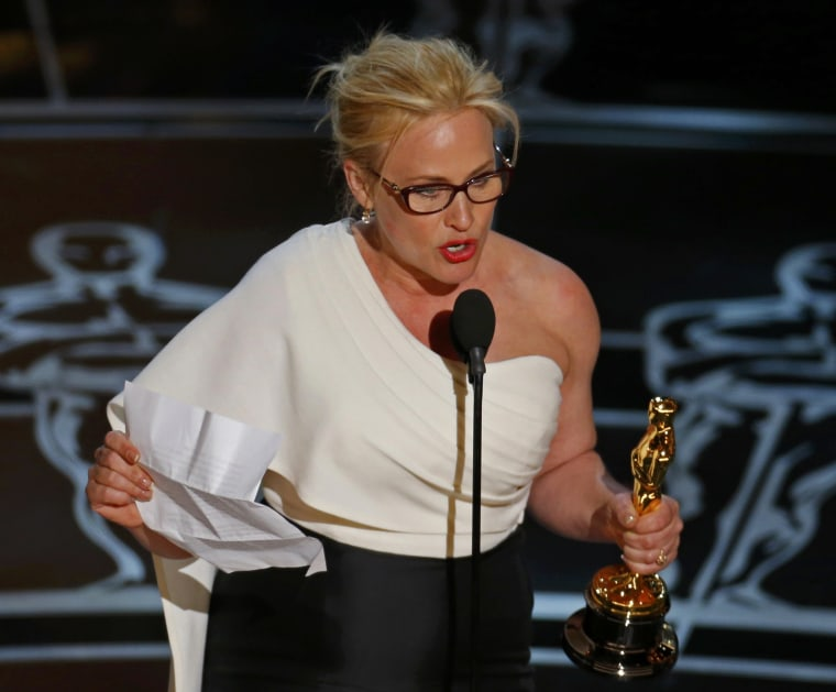 """Image: Patricia Arquette speaks after winning the Oscar for Best Supporting Actress for her role in """"Boyhood"""" at the 87th Academy Awards in Hollywood, California"""