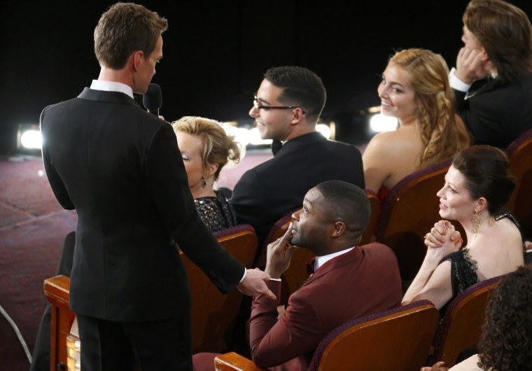 Image: Presenter Neil Patrick Harris  talks with actor David Oyelowo at the 87th Academy Awards in Hollywood, California