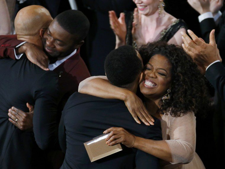 """Image: Winfrey and Oyelowo congratulate Legend and Common after """"Glory"""" won the Oscar for best original song during the 87th Academy Awards in Hollywood"""