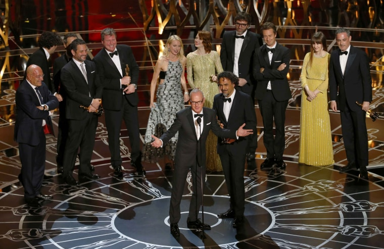 """Image: Actor Keaton and director Inarritu accept the Oscar for best picture for his film """"Birdman""""during the 87th Academy Awards in Hollywood"""