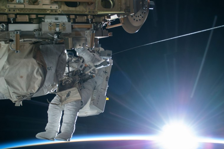 Image: NASA astronaut Terry Virts Flight Engineer of Expedition 42 is seen working to complete a cable routing task while near the forward facing port of the Harmony module on the International Space Station