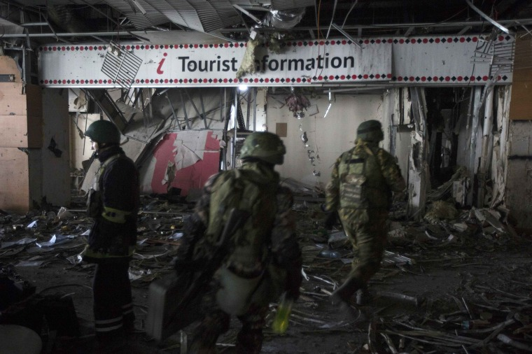 Image: Armed men of the separatist self-proclaimed Donetsk People's Republic army are seen in the damaged Donetsk airport