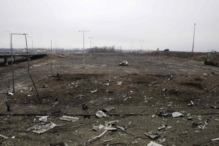 Image: A vehicle is seen in a car park, damaged by months of fighting, at the Donetsk airport