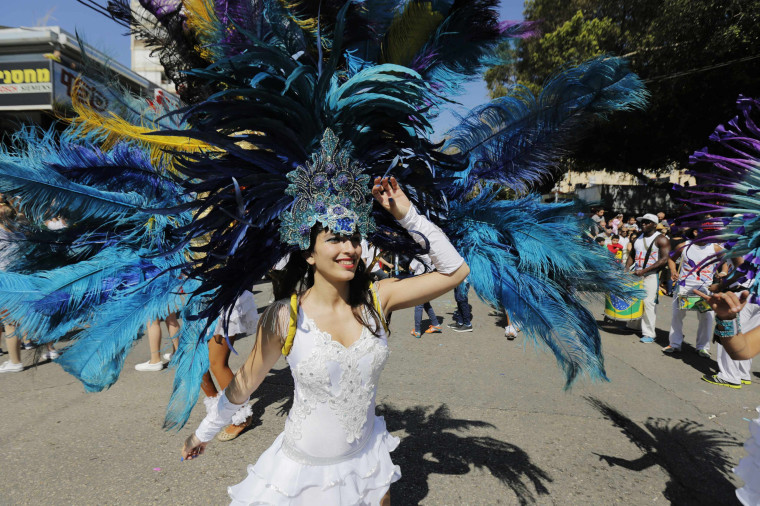 Image: A dancer performs during the annual parade marking Purim near Tel Aviv