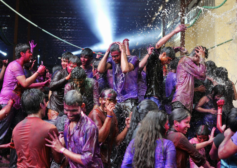 Image: People are drenched with water as they celebrate Holi in southern Indian city of Bengaluru