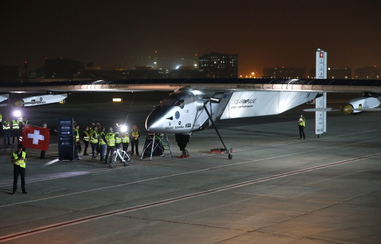 Image: The Solar Impulse 2 prepares to take off at Al Bateen airport in Abu Dhabi