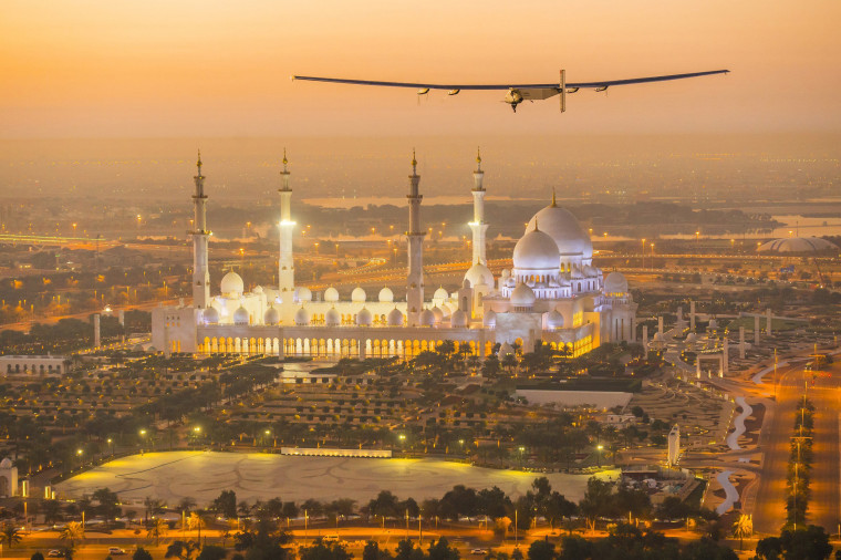 Image: The Solar Impulse 2, a solar-powered plane, flies over the Sheikh Zayed Grand Mosque in Abu Dhabi