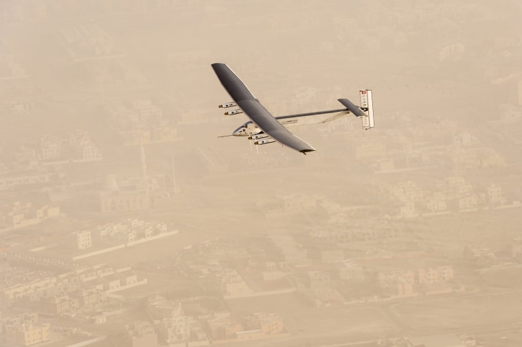 Image: A view of the Solar Impulse 2 on flight after taking off from Al Bateen Airport in United Arab Emirates