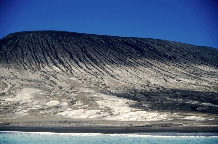 New volcanic island (centre) forms a trio with the older Hunga Tonga and Hunga Ha'apai volcanic islets, Tonga, Pacific Islands.  Photographer GP Orbassano. 6 March 2015.