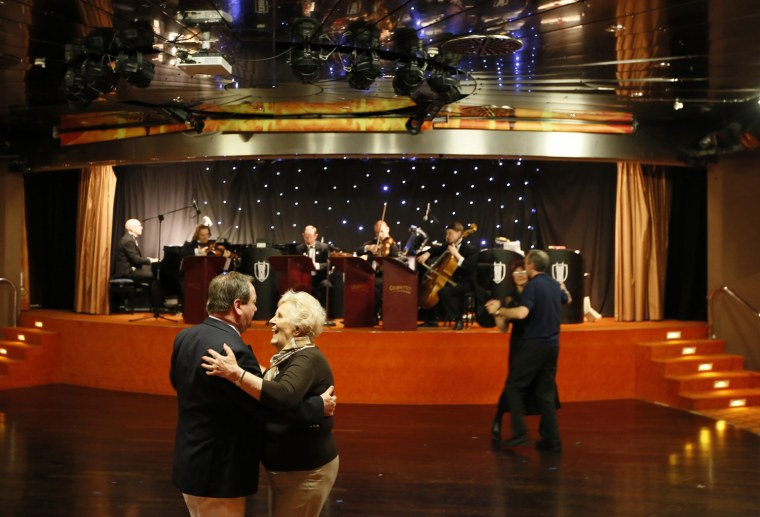 Image: Passengers on the Titanic Memorial Cruise dance to a Belgian string band after departure from Cobh