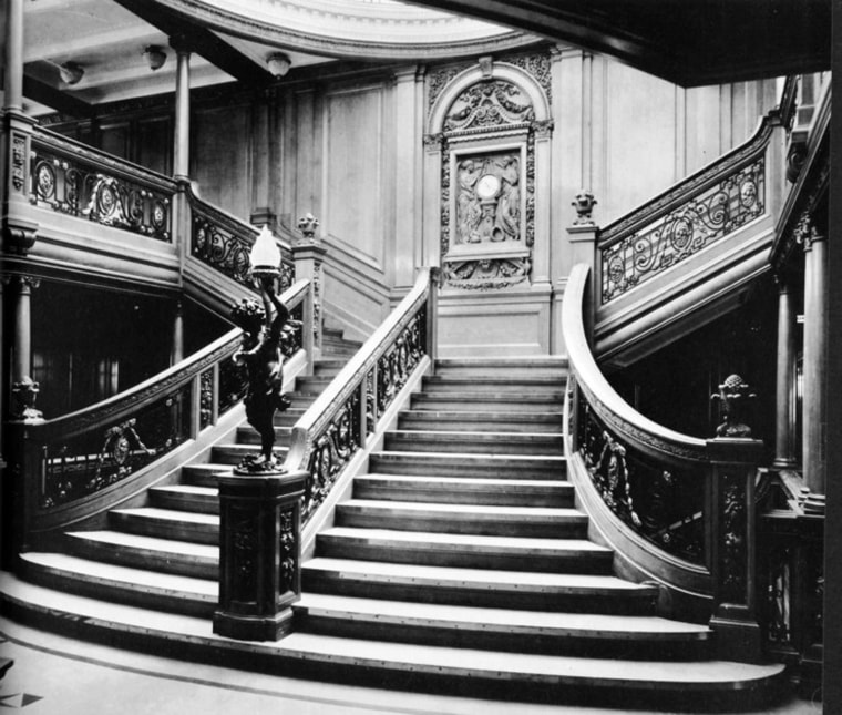 Image: The grand staircase between the boat deck and the promenade deck aboard the RMS Titanic.