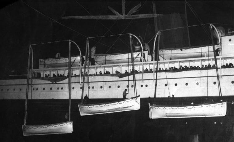 Image: Lifeboats which carried survivors of the sinking of the RMS Titanic are uploaded to the RMS Carpathia in the hours after the disaster.