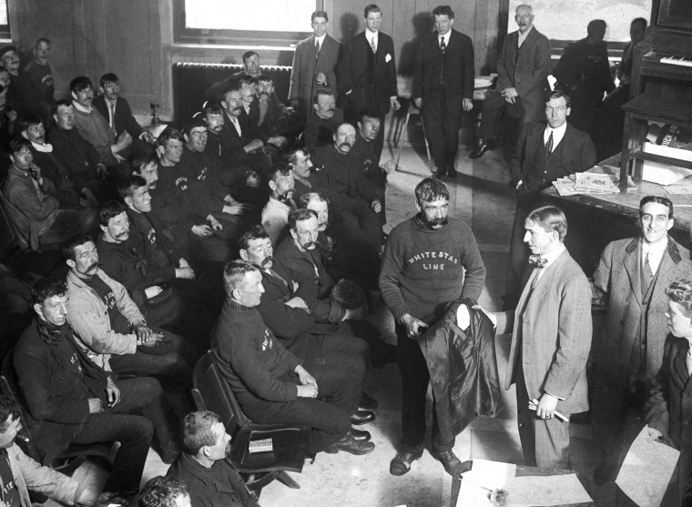 Image: Crew members who survived the sinking of the RMS Titanic are given dry clothing in New York.