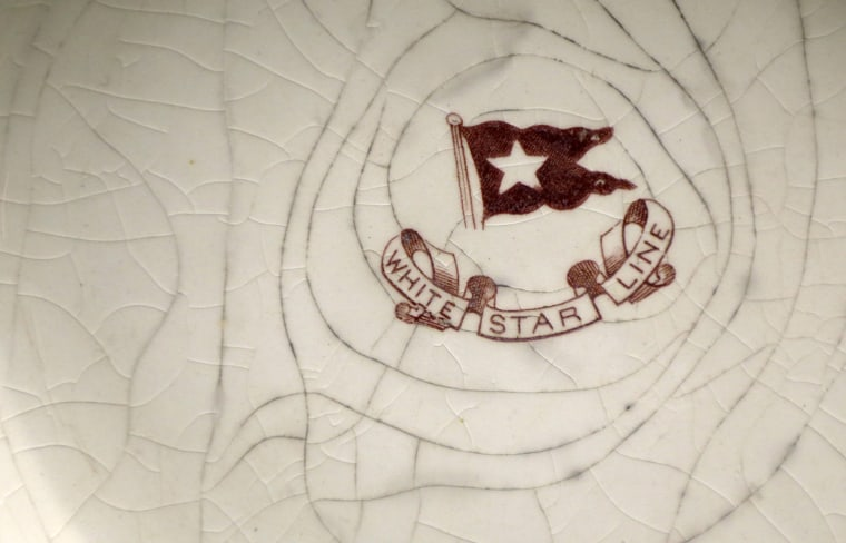 Image: The White Star Line logo is seen on a bowl recovered from the wreck site of Titanic at the opening of a new exhibition at the Merseyside Maritime Museum