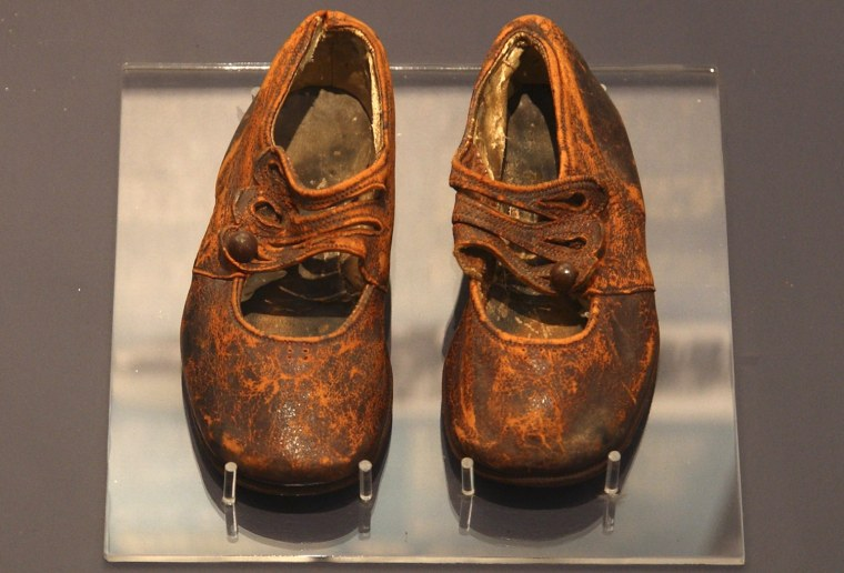 Image: Child's shoes believed to be from body of an unknown boy on Titanic are seen in Maritime Museum of the Atlantic in Halifax