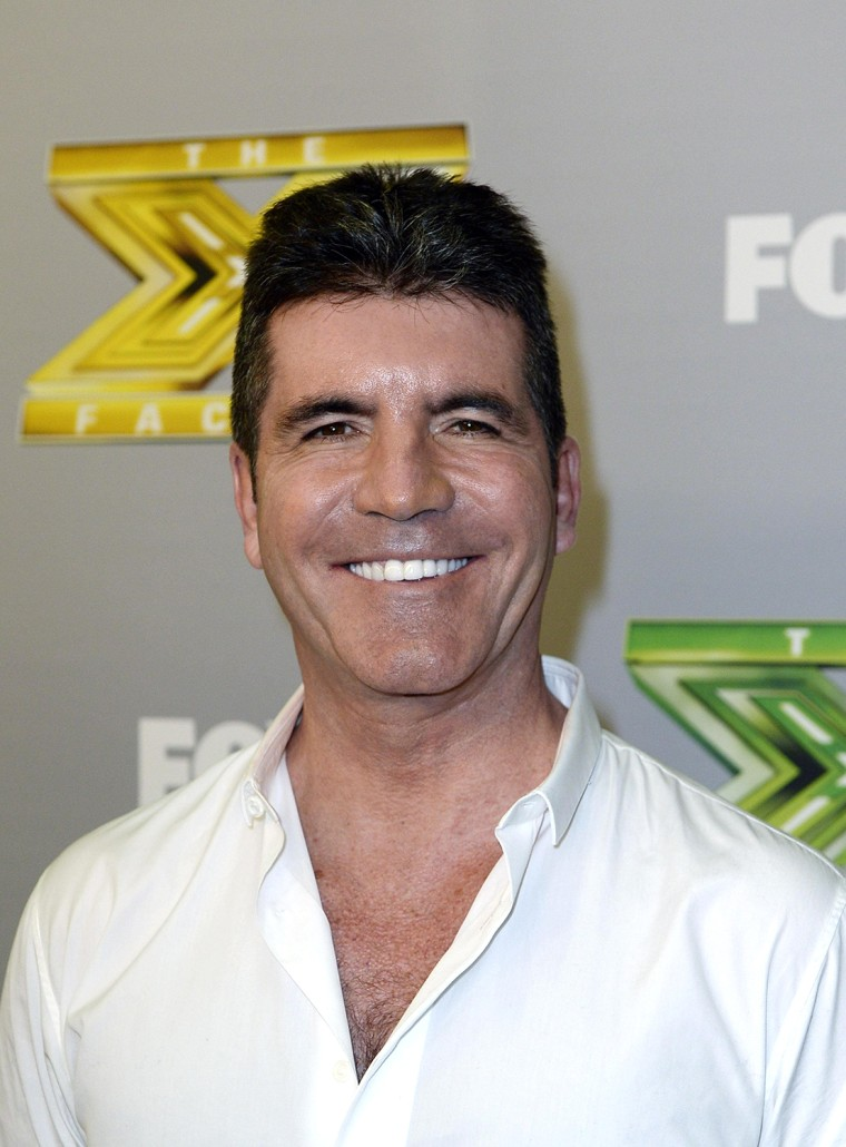 """Image: Simon Cowell poses backstage after """"The X Factor """" finale in Los Angeles"""