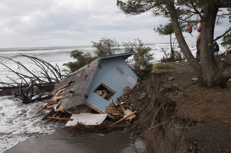 Image: A home sits off of its foundation in Washaway Beach, Washington