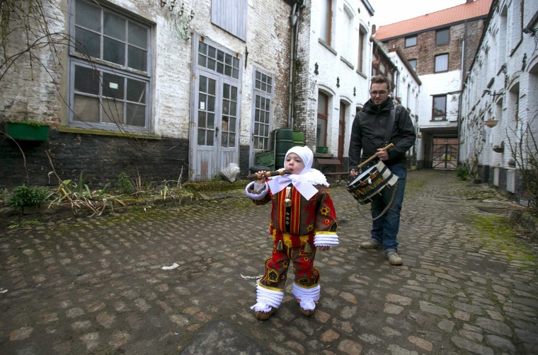 Image: Belleri walks on his way to the parade of Young Gilles of Binche during the carnival event in Binche during the carnival event in Binche