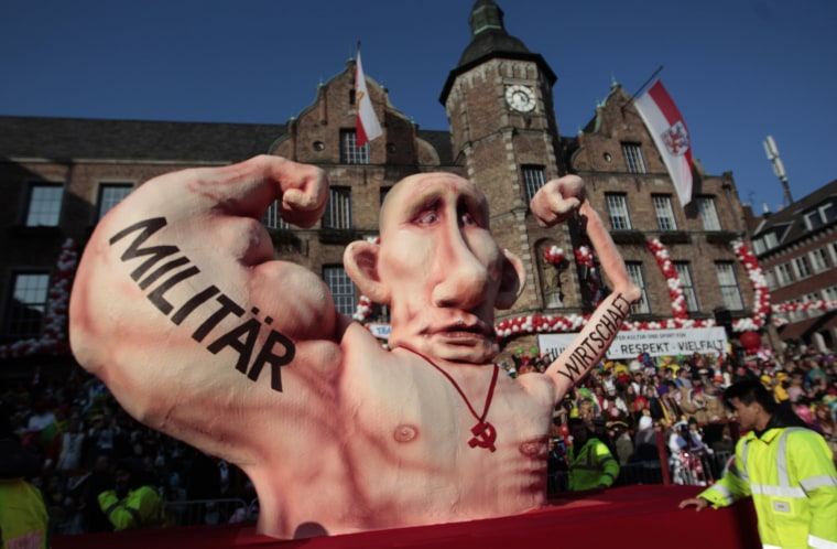 Image: Carnival float with a paper-mache caricature of Russia's President Vladimir Putin drives past revellers during the traditional Rose Monday carnival parade in the western German city of Duesseldorf