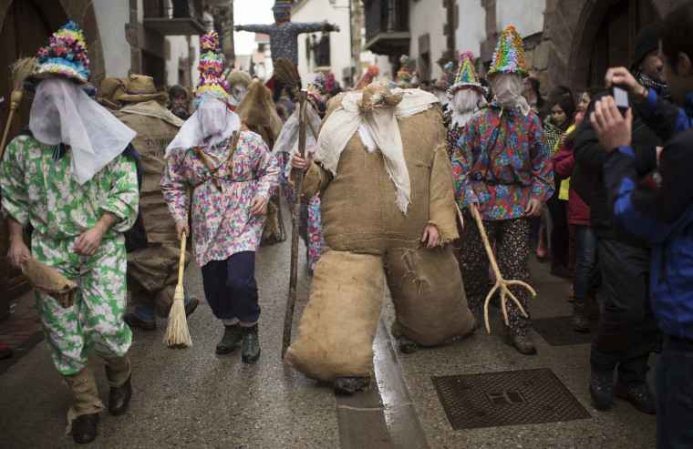 Image: Ziripot, a traditional figure stuffed with straw, takes part in carnival celebrations in Lantz