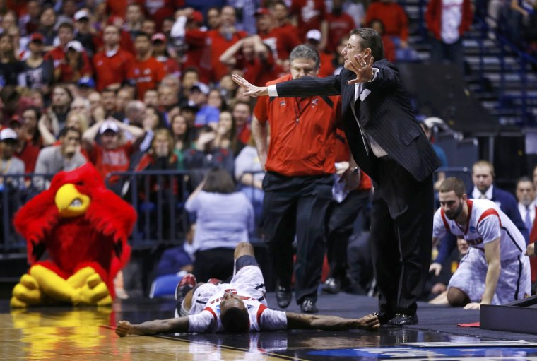 Image: Louisville coach Pitino calls to the referees to stop the game as guard Kevin Ware lays on the court against Duke during their Midwest Regional NCAA men's basketball game in Indianapolis