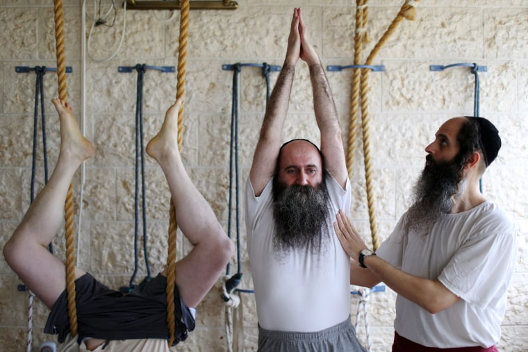 Image: Ultra Orthodox Jews practice yoga