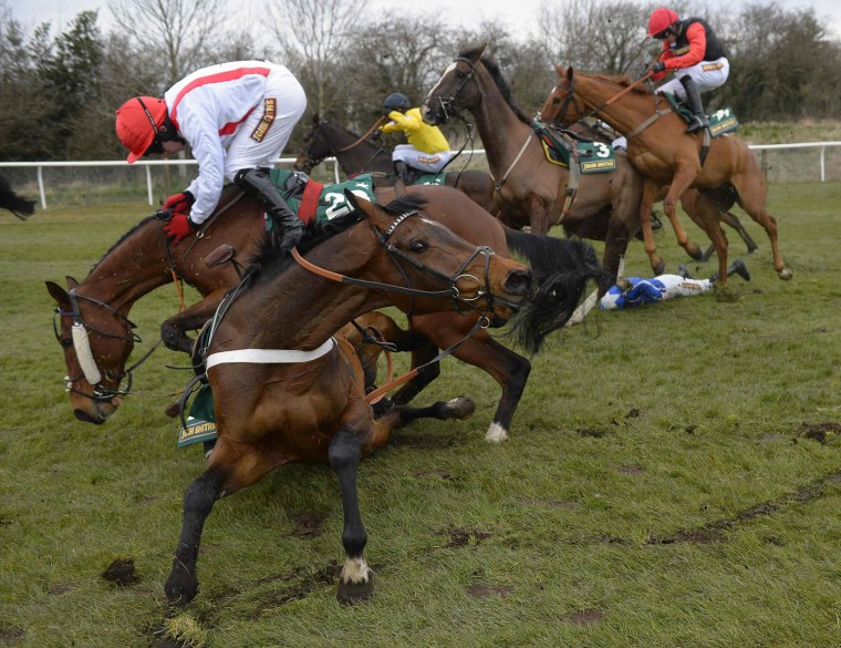 Image: Jockey Condon struggles to stay on board Jamsie Hall at the 11th fence in the fourth race of the day of The Topham Steeple Chase at Aintree, northern England