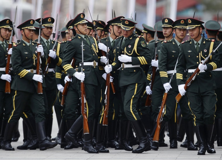 Image: Honour guard troops line up before a welcome ceremony for New Zealand's Prime Minister John Key outside the Great Hall of the People in Beijing