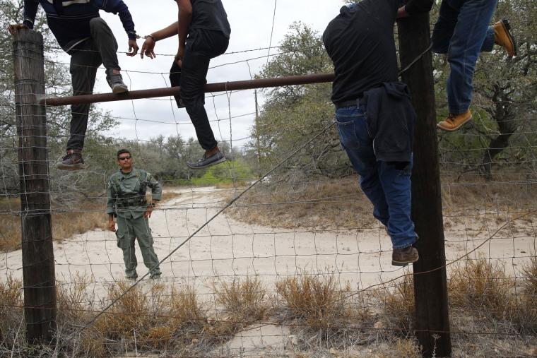 Image: People are taken into custody by the U.S. Border Patrol near Falfurrias, Texas