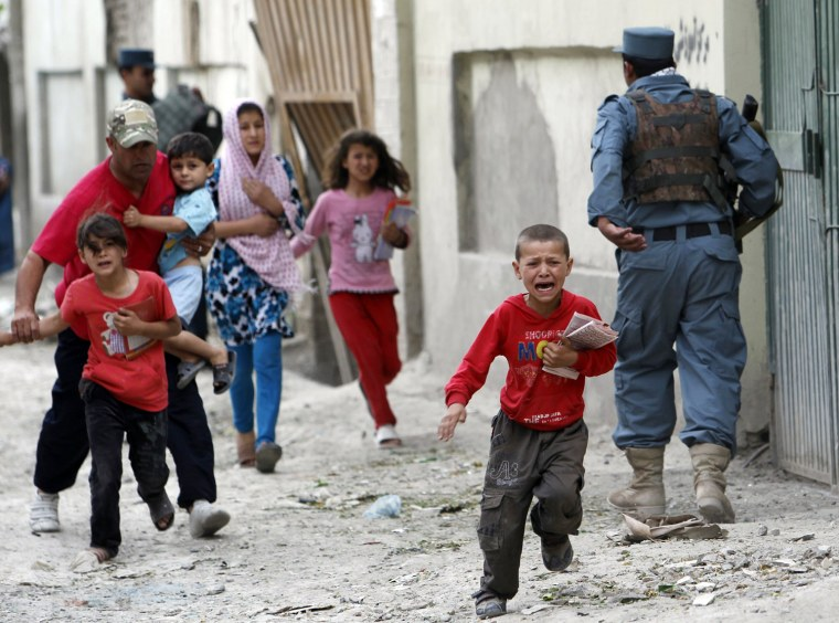 Image: Children run away after an explosion in Kabul