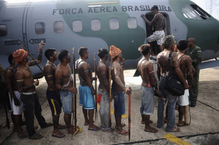 Image: Munduruku Indians board a Brazilian Air Force plane to fly to Brasilia