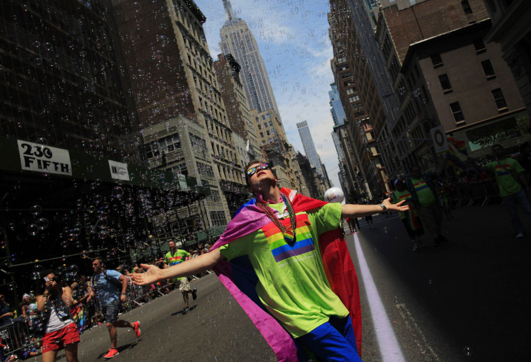 Image: A man dances at the Gay Pride Parade in New York