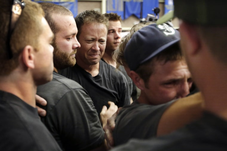 Image: Firefighters gather during a memorial service Monday, July 1, 2013, in Prescott, Ariz., honoring their 19 fellow firefighters killed battling a wildfire near Yarnell, Ariz.