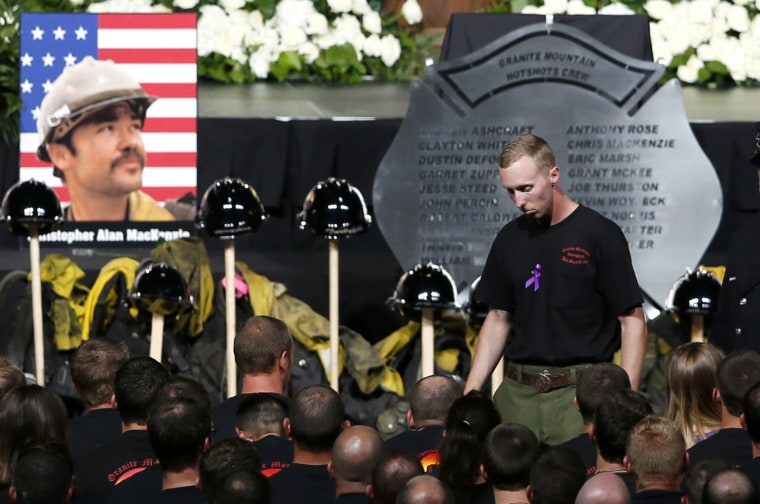Image: Surviving Hotshot crew member McDonough walks back to his seat after speaking at a memorial service for the fallen members of the Granite Mountain Hotshots, in Prescott Valley